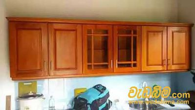 wood finished pantry cupboards